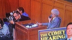 Comey Hearing court reporter using a stenomask